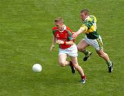 26 September 2004; David Heaney, Mayo, in action against Dara O Cinneide, Kerry. Bank of Ireland All-Ireland Senior Football Championship Final, Kerry v Mayo, Croke Park, Dublin. Picture credit; Pat Murphy / SPORTSFILE *** Local Caption *** Any photograph taken by SPORTSFILE during, or in connection with, the 2004 Bank of Ireland All-Ireland Senior Football Final which displays GAA logos or contains an image or part of an image of any GAA intellectual property, or, which contains images of a GAA player/players in their playing uniforms, may only be used for editorial and non-advertising purposes.  Use of photographs for advertising, as posters or for purchase separately is strictly prohibited unless prior written approval has been obtained from the Gaelic Athletic Association.