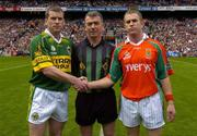 26 September 2004; Kerry captain Dara O Cinneide shakes hands with Mayo captain Gary Ruane in the presence of referee Pat McEnaney. Bank of Ireland All-Ireland Senior Football Championship Final, Kerry v Mayo, Croke Park, Dublin. Picture credit; Ray McManus / SPORTSFILE *** Local Caption *** Any photograph taken by SPORTSFILE during, or in connection with, the 2004 Bank of Ireland All-Ireland Senior Football Final which displays GAA logos or contains an image or part of an image of any GAA intellectual property, or, which contains images of a GAA player/players in their playing uniforms, may only be used for editorial and non-advertising purposes.  Use of photographs for advertising, as posters or for purchase separately is strictly prohibited unless prior written approval has been obtained from the Gaelic Athletic Association.