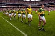 26 September 2004; The Kerry team led by Dara O Cinneide during the pre-match parade. Bank of Ireland All-Ireland Senior Football Championship Final, Kerry v Mayo, Croke Park, Dublin. Picture credit; Ray McManus / SPORTSFILE *** Local Caption *** Any photograph taken by SPORTSFILE during, or in connection with, the 2004 Bank of Ireland All-Ireland Senior Football Final which displays GAA logos or contains an image or part of an image of any GAA intellectual property, or, which contains images of a GAA player/players in their playing uniforms, may only be used for editorial and non-advertising purposes.  Use of photographs for advertising, as posters or for purchase separately is strictly prohibited unless prior written approval has been obtained from the Gaelic Athletic Association.