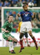 9 October 2004; Thierry Henry, France, in action against Andy O'Brien, Republic of Ireland. FIFA World Cup 2006 Qualifier, France v Republic of Ireland, Stade de France, Paris, France. Picture credit; David Maher / SPORTSFILE