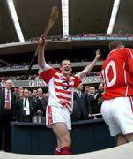 12 September 2004; Cork goalkeeper Donal Og Cusack celebrates after victory over Kilkenny. Guinness All-Ireland Senior Hurling Championship Final, Cork v Kilkenny, Croke Park, Dublin. Picture credit; Brendan Moran / SPORTSFILE *** Local Caption *** Any photograph taken by SPORTSFILE during, or in connection with, the 2004 Guinness All-Ireland Hurling Final which displays GAA logos or contains an image or part of an image of any GAA intellectual property, or, which contains images of a GAA player/players in their playing uniforms, may only be used for editorial and non-advertising purposes.  Use of photographs for advertising, as posters or for purchase separately is strictly prohibited unless prior written approval has been obtained from the Gaelic Athletic Association.