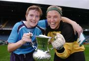 24 October 2004;  UCD captain Sylvia Gee, left, with team-mate Niamh Spratt, celebrates at the end of the game after victory over Dundalk. 2004 FAI Ladies National Senior Cup Final, UCD v Dundalk, Lansdowne Road, Dublin. Picture credit; David Maher / SPORTSFILE