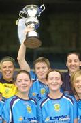 24 October 2004; Sylvia Gee, UCD captain, lifts the cup after victory against Dundalk. 2004 FAI Ladies National Senior Cup Final, UCD v Dundalk, Lansdowne Road, Dublin. Picture credit; Matt Browne / SPORTSFILE