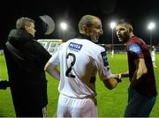 25 October 2013; Bohemians caretaker manager Owen Heary is congratulated by Drogheda United's Gavin  Brennan as he comes on as a substitute for his last game. Airtricity League Premier Division, Drogheda United v Bohemians, Hunky Dorys Park, Drogheda, Co. Louth. Picture credit: David Maher / SPORTSFILE