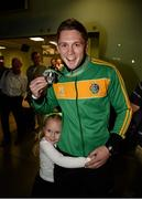 27 October 2013; Ireland's Jason Quigley, from Finn Valley BC, Donegal, with his AIBA World Boxing Championships silver medal and his six year old sister Holli on his arrival home from the AIBA World Boxing Championships Almaty 2013 in Kazakhstan. Dublin Airport, Dublin. Picture credit: Paul Mohan / SPORTSFILE