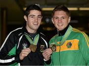 27 October 2013; Ireland's Jason Quigley, right, from Finn Valley BC, Donegal, with his AIBA World Boxing Championships silver medal, and Joe Ward, Moate BC, Co. Westmeath, with his bronze medal on their arrival home from the AIBA World Boxing Championships Almaty 2013 in Kazakhstan. Dublin Airport, Dublin. Picture credit: Paul Mohan / SPORTSFILE
