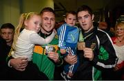 27 October 2013; Ireland's Jason Quigley, left, from Finn Valley BC, Donegal, with his AIBA World Boxing Championships silver medal and his six year old sister Holli, and Ireland's Joe Ward with his bronze medal and two year old son Joe, on their arrival home from the AIBA World Boxing Championships Almaty 2013 in Kazakhstan.n. Dublin Airport, Dublin. Picture credit: Paul Mohan / SPORTSFILE