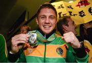 27 October 2013; Ireland's Jason Quigley, from Finn Valley BC, Donegal, with his AIBA World Boxing Championships silver medal on his arrival home from the AIBA World Boxing Championships Almaty 2013 in Kazakhstan. Dublin Airport, Dublin. Picture credit: Paul Mohan / SPORTSFILE