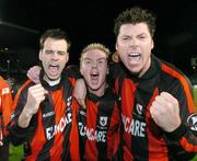 24 October 2004; Longford Town players, left to right, John Martin, Dessie Baker and Dean Fitzgerald celebrate at the end of the game after victory over Waterford United. 2004 FAI Carlsberg Cup Final, Longford Town v Waterford United, Lansdowne Road, Dublin. Picture credit; David Maher / SPORTSFILE