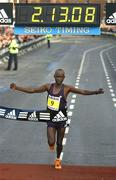 25 October 2004; Lezan Kimutai, of Kenya, comes home to win the Men's race in a record time time of 2:13:08. His time broke the 22 year record held by Jerry Kiernan of Ireland. adidas Dublin City Marathon 2004. Merrion Square, Dublin. Picture credit; Brendan Moran / SPORTSFILE