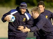 26 October 2004; Felipe Contepomi is tackled by team-mate David McAllister during Leinster Rugby squad training. Old Belvedere Rugby Club, Anglesea Road, Dublin. Picture credit; Matt Browne / SPORTSFILE