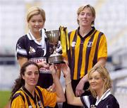 1 November 2004; Aoife Sheehan, Granagh-Ballingarry, Limerick, back left, and Gillian Dillon Maher, St. Lachtain's of Freshford, Kilkenny, back right, with front left, Imelda Kennedy, St. Lachtain's of Freshford, Kilkenny, and Deirdre Sheehan, front right, from Granagh-Ballingarry, Limerick, with the Bill Carroll cup, at a photocall ahead of the senior camogie Club Final between Granagh-Ballingarry, Limerick and St. Lachtain's of Freshford, Kilkenny. Croke Park, Dublin. Picture credit; Damien Eagers / SPORTSFILE