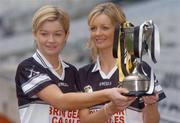 1 November 2004; Granagh-Ballingarry, Limerick, players Aoife Sheehan, left with her sister Deirdre with the Bill Carroll Cup at a photocall ahead of the senior camogie Club Final between Granagh-Ballingarry, Limerick and St. Lachtain's of Freshford, Kilkenny. Croke Park, Dublin. Picture credit; Ciara Lyster / SPORTSFILE
