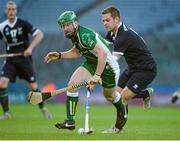 26 October 2013; Cahir Healy, Ireland, in action against Norman Campbell, Scotland. Shinty International First Test, Ireland v Scotland, Croke Park, Dublin. Picture credit: Ray McManus / SPORTSFILE
