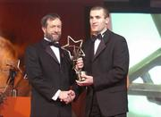 26 November 2004; Jerry O'Connor of Cork, is presented with his All-Star award by Sean Kelly, President of the GAA, at the 2004 Vodafone GAA All-Star Awards. Citywest, Dublin. Picture credit; Brendan Moran / SPORTSFILE