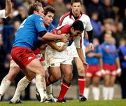 4 December 2004; Kieran Campbell, Ulster, is tackled by Brian Liebenberg (left) and Shaun Sowerby, Stade Francais. Heineken European Cup 2004-2005, Pool 6, Round 3, Stade Francais v Ulster, Stade Jean Bouin, Paris, France. Picture credit; Brian Lawless / SPORTSFILE