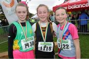 17 November 2013; Competitors, from left, Nicola Duffy, Leinster, Sarah Healy, Blackrock, Co. Dublin, and Jodie McCann, D.S.D, Co. Dublin, after the Girls U14's race at the 2013 Woodie's DIY Inter County & Juvenile Even Age Cross Country Championships of Ireland. Santry Demesne, Santry, Co. Dublin. Picture credit: Ramsey Cardy / SPORTSFILE