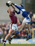23 January 2005; John Brennan, Westmeath, in action against Padraig McMahon, Laois. O'Byrne Cup Final, Westmeath v Laois, Cusack Park, Mullingar, Co. Westmeath. Picture credit; David Maher / SPORTSFILE