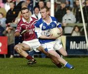 23 January 2005; Donal Brennan, Laois, in action against Daniel McDermott, Westmeath. O'Byrne Cup Final, Westmeath v Laois, Cusack Park, Mullingar, Co. Westmeath. Picture credit; David Maher / SPORTSFILE