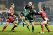 23 November 2013; Gavin Duffy, Connacht, is tackled by Nick Reynolds, left, and Gareth Owen, Scarlets. Celtic League 2013/14, Round 8, Connacht v Scarlets, The Sportsground, Galway. Picture credit: Diarmuid Greene / SPORTSFILE
