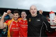 24 November 2013; Castlebar Mitchels manager Pat Holmes celebrates with captain Donal Newcombe, left, and James Durcan at the end of the game. AIB Connacht Senior Club Football Championship Final, St Brigid's, Roscommon, v Castlebar Mitchels, Mayo. Dr. Hyde Park, Roscommon. Picture credit: David Maher / SPORTSFILE