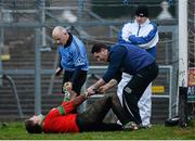 24 November 2013;  St Brigid's goalkeeper Shane Curran is helped off the pitch by referee Marty Duffy before being substituted during extra time. AIB Connacht Senior Club Football Championship Final, St Brigid's, Roscommon, v Castlebar Mitchels, Mayo. Dr. Hyde Park, Roscommon. Picture credit: David Maher / SPORTSFILE