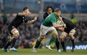24 November 2013; Jamie Heaslip, Ireland, is tackled by Liam Messam, left, Ma'a Nonu and Richie McCaw, New Zealand. Guinness Series International, Ireland v New Zealand, Aviva Stadium, Lansdowne Road, Dublin. Picture credit: Brendan Moran / SPORTSFILE
