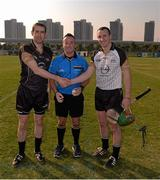 30 November 2013; The two captains, Patrick Donnellan, Clare, GAA GPA All-Stars 2013, left, and Eoin Larkin, Kilkenny, GAA GPA All-Stars 2012, shake hands accross the referee James McGrath before the game. GAA GPA All-Stars 2013 Exhibition Match, GAA GPA All-Stars 2013 v GAA GPA All-Stars 2012, Sponsored by Opel. Shanghai Rugby Football Club, Zhangyang Bei Lu, Wuzhou Da Dao, Shanghai, China. Picture credit: Ray McManus / SPORTSFILE