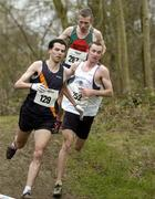 19 February 2005; Eventual winner Gary Murray, St. Malachy's, right, runs alongside eventual second place Mark Kenneally, Clonliffe Harriers A.C., and Seamus Power, behind, during the Senior Mens event. AAI National Inter Club Cross Country Championships, Santry, Dublin. Picture credit; Brian Lawless / SPORTSFILE