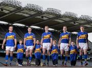 5 December 2013; ŠKODA Ireland today announced the extension of its sponsorship of Tipperary GAA by another year, bringing its investment over the four year partnership to €800,000. To mark the deal, the new 2014 Tipperary GAA strip was unveiled at Croke Park today. The strip features a special 1884 motif to commemorate 130 years of Tipperary GAA. Pictured at Croke Park announcing the extension of the ŠKODA sponsorship are Tipperary senior stars, from left, Noel McGrath, hurling, Paddy Codd, Alan Campbell, both football, Kieran Bergin and Brendan Maher, both hurling, with future Tipperary stars, from left, Carlie Walsh, age 6, from Fethard, Danny Shelly, age 6, from Killusty, Rory O'Mahony, age 6, from Fethard, and Sam Coen, age 5, from Fethard. Picture credit: Stephen McCarthy / SPORTSFILE
