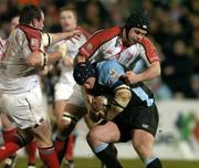 4 March 2005; Kevin Tkachuk, Glasgow Rugby, is tackled by Matt McCullough, Ulster. Celtic League 2004-2005, Pool 1, Ulster v Glasgow Rugby, Ravenhill, Belfast. Picture credit; Matt Browne / SPORTSFILE