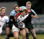 4 March 2005; Roger Wilson, Ulster, is tackled by Rory Lamont, left and Cameron Mather, Glasgow Rugby. Celtic League 2004-2005, Pool 1, Ulster v Glasgow Rugby, Ravenhill, Belfast. Picture credit; Matt Browne / SPORTSFILE