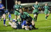 7 December 2013; Marie Louise Reilly, Leinster, scores a try against Connacht despite the tackle of Nichole Frowley and Lisa McDonnagh. Women's Interprovincial, Leinster v Connacht, Ashbourne RFC, Ashbourne, Co. Meath. Picture credit: Matt Browne / SPORTSFILE