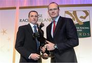 9 December 2013; Jockey Jamie Codd, left, is presented with his Point to Point Award by Simon Coveney T.D, Minister for Agriculture, Food and the Marine. Horse Racing Ireland Awards, The Pavilion, Leopardstown Racecourse, Leopardstown, Co. Dublin. Picture credit: David Maher / SPORTSFILE
