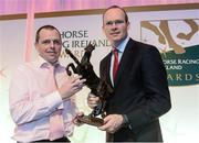 9 December 2013; Jockey Barry Cash, left, is presented with his Outstanding Achievement Award by Simon Coveney T.D, Minister for Agriculture, Food and the Marine. Horse Racing Ireland Awards, The Pavilion, Leopardstown Racecourse, Leopardstown, Co. Dublin. Picture credit: David Maher / SPORTSFILE