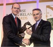 9 December 2013; Irish owner-breeder and trainer Jim Bolger, right, is presented with his Contribution to Industry Award by Simon Coveney T.D, Minister for Agriculture, Food and the Marine. Horse Racing Ireland Awards, The Pavilion, Leopardstown Racecourse, Leopardstown, Co. Dublin. Picture credit: David Maher / SPORTSFILE