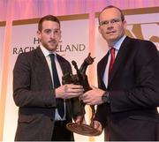 9 December 2013; Brendan Boyd accepts the Horse of the year award from the Minister for Agriculture, Food and the Marine Simon Coveney T.D. Horse Racing Ireland Awards, The Pavilion, Leopardstown Racecourse, Leopardstown, Co. Dublin. Picture credit: David Maher / SPORTSFILE