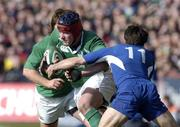 12 March 2005; Anthony Foley, Ireland, is tackled by Christophe Dominici, France. RBS Six Nations Championship 2005, Ireland v France, Lansdowne Road, Dublin. Picture credit; Damien Eagers / SPORTSFILE