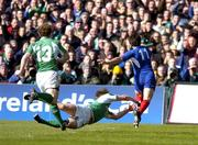 12 March 2005; Christophe Dominici, France, gets past the tackle of Denis Hickie, Ireland, to score his sides first try. RBS Six Nations Championship 2005, Ireland v France, Lansdowne Road, Dublin. Picture credit; Brendan Moran / SPORTSFILE