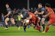 14 December 2013; Mick Kearney, Connacht, is tackled by Schalk Ferreira, left, and Romain Millo-Chluski, Toulouse. Heineken Cup 2013/14, Pool 3, Round 4, Connacht v Toulouse. Sportsground, Galway. Picture credit: Matt Browne / SPORTSFILE
