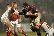 18 March 2005; Tom Bowman, Munster, is tackled by Kieran Campbell (9), and Paul Steinmetz, Ulster. Celtic League 2004-2005, Pool 1, Munster v Ulster, Musgrave Park, Cork. Picture credit; Matt Browne / SPORTSFILE