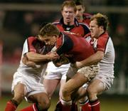 18 March 2005; Sean Payne, Munster, is tackled by Kieran Campbell, left, and Scott Young, Ulster. Celtic League 2004-2005, Pool 1, Munster v Ulster, Musgrave Park, Cork. Picture credit; Matt Browne / SPORTSFILE