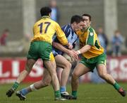 20 March 2005; Declan Lally, Dublin, in action against Damien Diver, left, and Kevin Cassidy, Donegal. Allianz National Football League, Division 1A, Dublin v Donegal, Parnell Park, Dublin. Picture credit; Brian Lawless / SPORTSFILE