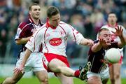 27 March 2005; Mickey Coleman, Tyrone, is blocked down by John Brennan, Westmeath. Allianz National Football League, Division 1A, Westmeath v Tyrone, Cusack Park, Mullingar, Co. Westmeath. Picture credit; Oliver McVeigh / SPORTSFILE