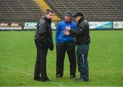 5 January 2014; Referee Padraig Hughes, left, in discussion with St Mary's manager Paddy Tally, centre, and Fermanagh manager Peter McGrath during a pitch inspection which resulted in the game being called off. Power NI Dr. McKenna Cup, Section B, Round 1, Fermanagh v St Mary's, Brewster Park, Enniskillen, Co. Fermanagh. Picture credit: Oliver McVeigh / SPORTSFILE
