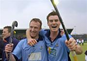 3 April 2005; Lisnagarvey's Philip Stirling, right, celebrates with team-mate and team captain Errol Lutton after victory in the final. Mens Irish Senior Cup Final, Instonians v Lisnagarvey, Belfield, UCD, Dublin. Picture credit; Brian Lawless / SPORTSFILE