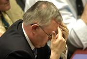 16 April 2005; GAA Presidential candidate Christy Cooney holds his head in his hands after defeat in the election during the 2005 GAA Congress. Croke Park, Dublin. Picture credit; Pat Murphy / SPORTSFILE