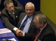16 April 2005; President of the GAA Sean Kelly congratulates President elect Nickey Brennan, right, as Tomas Moran, Vice President of the GAA, centre, looks on during the 2005 GAA Congress. Croke Park, Dublin. Picture credit; Pat Murphy / SPORTSFILE