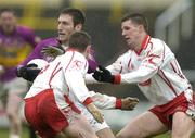 17 April 2005; Redmond Barry, Wexford, in action against Colin Holmes, right and Gavin Devlin, Tyrone. Allianz National Football League, Division 1 Semi-Final, Tyrone v Wexford, O'Moore Park, Portlaoise, Co. Laois. Picture credit; Pat Murphy / SPORTSFILE