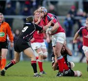 16 April 2005; Trevor Hogan, Munster, is tackled by Michael Blair, left, and Scott Murray, Edinburgh Rugby. Celtic League 2004-2005, Pool 1, Munster v Edinburgh Rugby, Thomond Park, Limerick. Picture credit; Kieran Clancy / SPORTSFILE